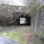 Under the railway as seen from Neath Road, looking towards the entrance to the Morfa works. Now blocked by security fencing and no longer accessible by a visitor interested in the site.